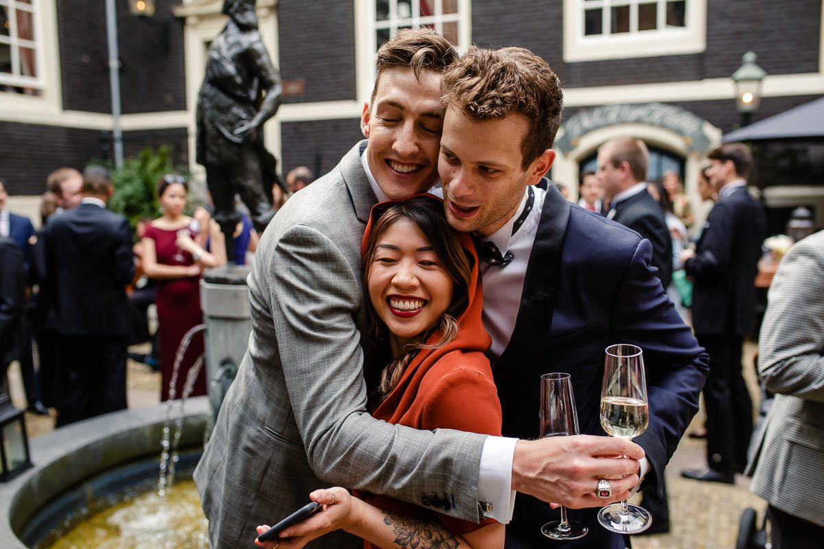 group hug weddingphotographer amsterdam